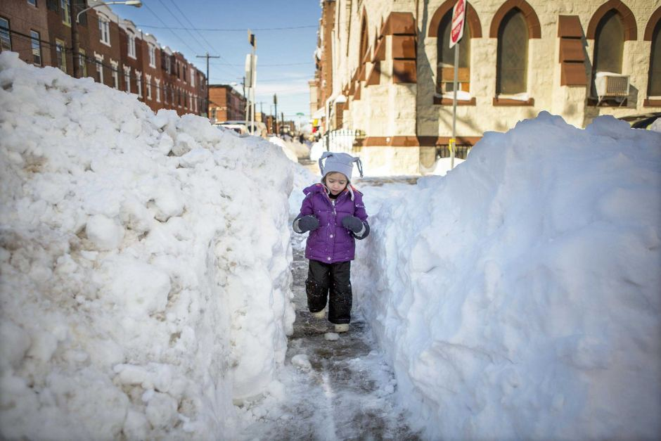 Child walking on snow path