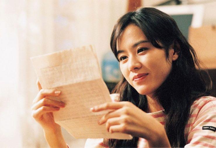 Girl reading a letter.