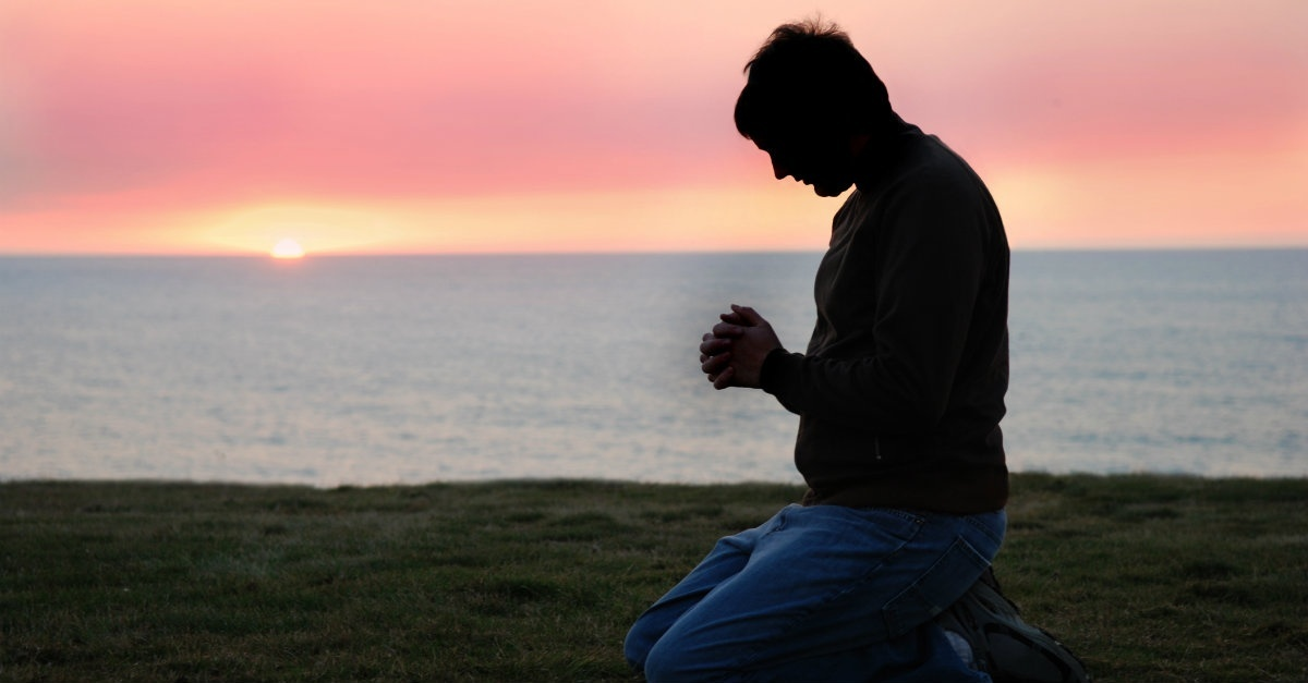 Man kneeling in prayer.