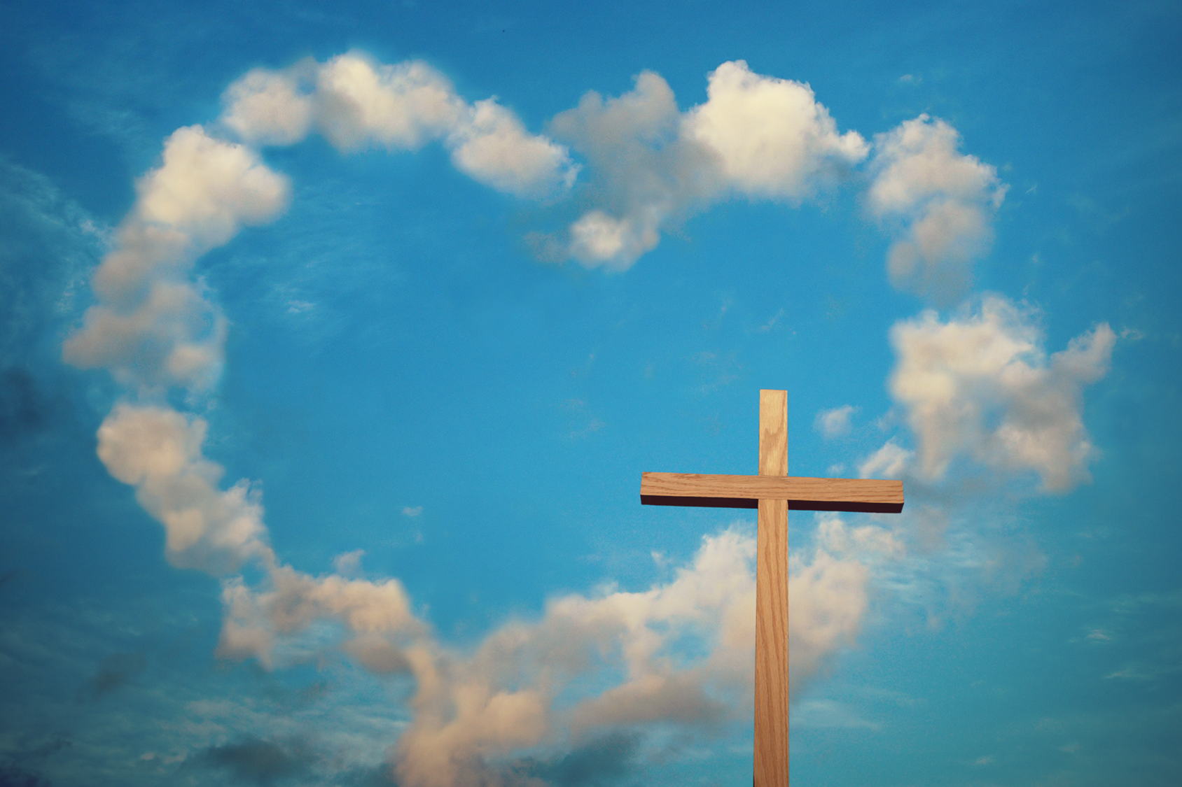 Heart shaped clouds and a cross.
