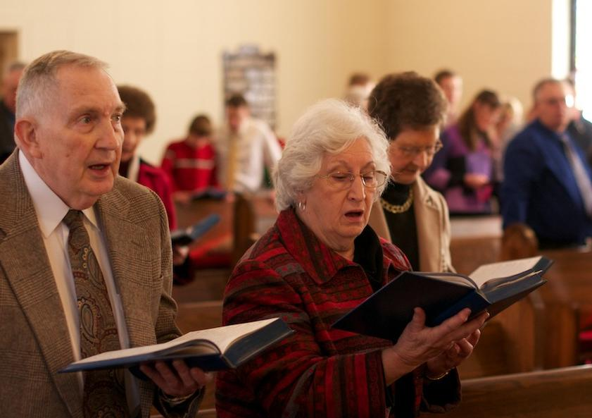 Couple singing in church.