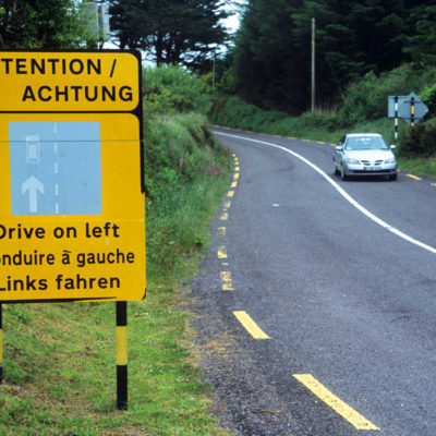 Drive on left sign.